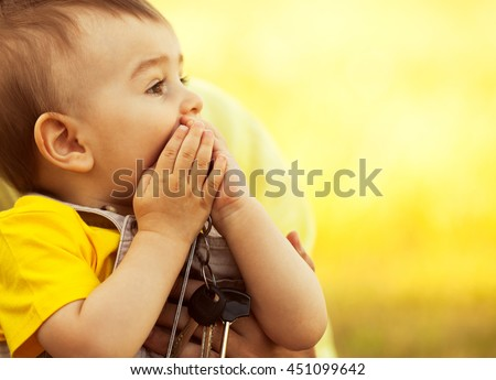 New place of residence concept. Father and little son in park. Dad holding baby. Sunny summer day. Child shocked of big house. Close up. Copy-space. Outdoor shot