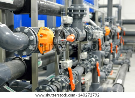 new plastic pipes and colorful equipment in industrial boiler room - stock photo