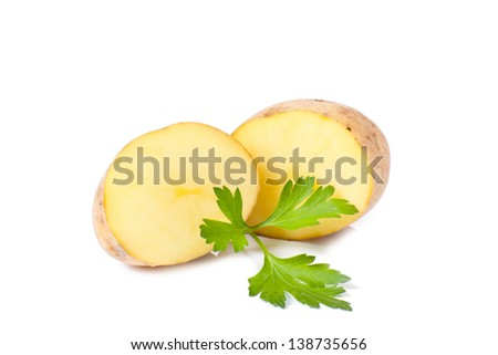 New potatoes and green parsley isolated on white background