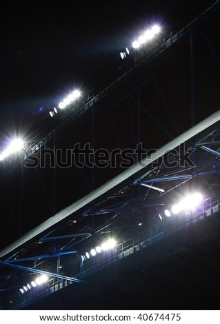 new powerfull lights on a soccer stadium - stock photo