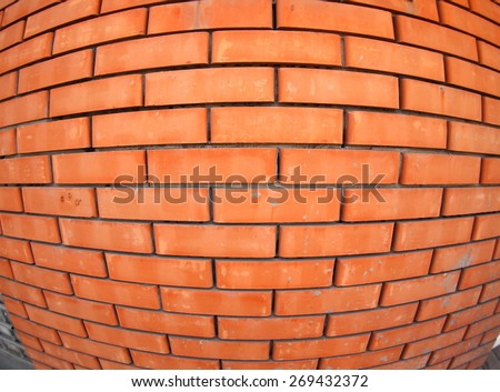 New red brick wall  with wide angle fisheye lens view closeup - stock photo