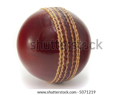 New red cricket ball, isolated on white background. - stock photo