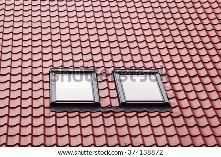 New red metal roof with skylights - stock photo