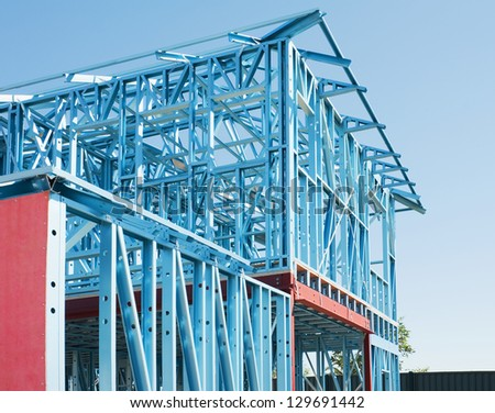 New residential construction home metal framing against a blue sky - stock photo