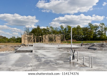 New residential construction house  with pre installed water pipes and sewage. Build your dream home. - stock photo