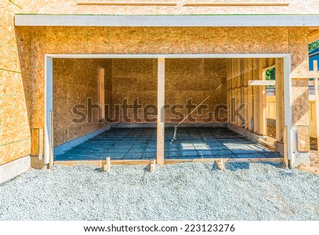 New residential home, garage under construction, framing. North America. - stock photo