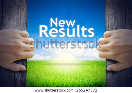 New results. Hands opening a wooden door then found a texts floating among new world as green grass field, Blue sky and the Sunrise. - stock photo