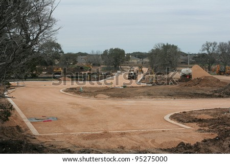 New road and neighborhood under construction - stock photo