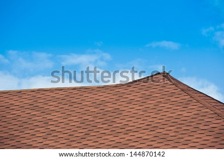 New roof covered with Bitumin tiles. - stock photo