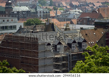 New roof on house in Fredericia City, Denmark, Scandinavia. High up view a beautiful hot summer day. - stock photo