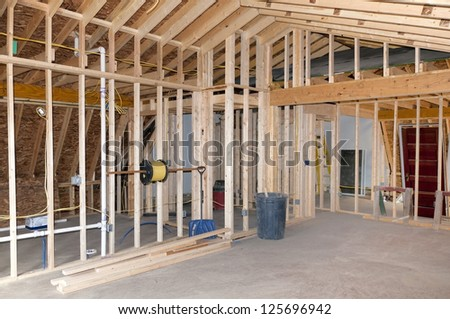 New Room addition construction to existing home - stock photo