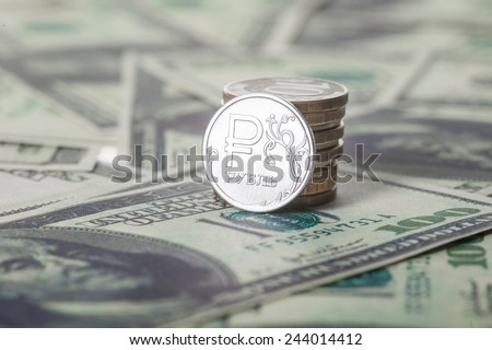 New russian ruble coin and american dollars. Closeup - stock photo