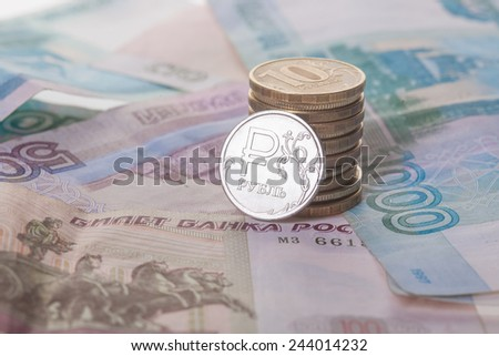 New russian ruble coin and banknotes. Closeup - stock photo