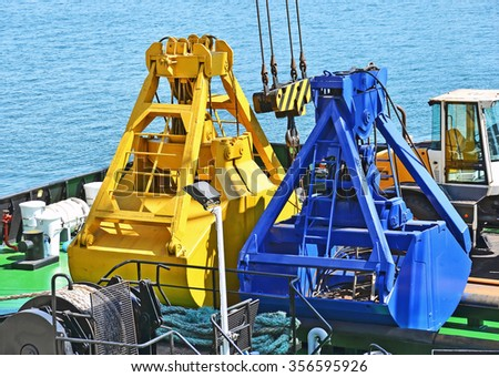 New scoop of cargo crane on the ship deck - stock photo