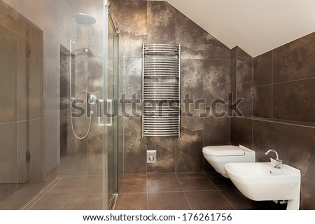 New shiny glass shower in brown bathroom - stock photo