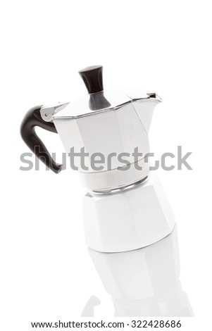New shiny moca pot isolated on white background with reflection. Traditional italian coffee machine.