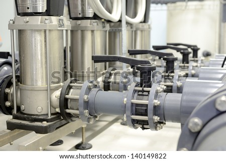 new shiny pipes in industrial boiler room - stock photo