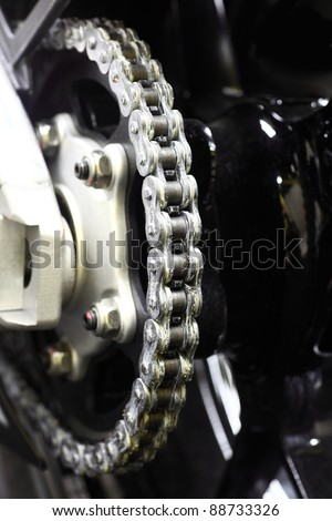 New shiny sport motorcycle chain - stock photo