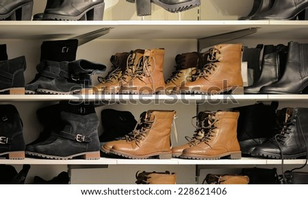 new shoes on a shelf in a shoe store  - stock photo