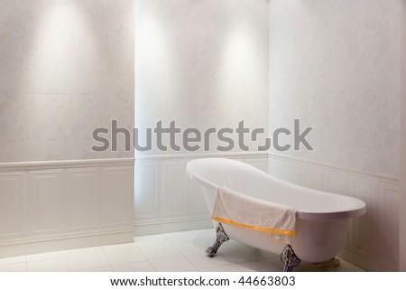 New simple modern bath with bathtub inside - stock photo