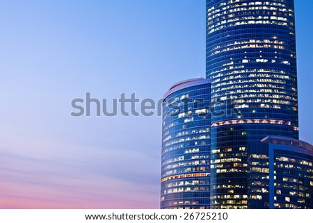 New skyscrapers at evening, sunshine - stock photo