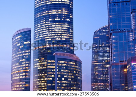New skyscrapers at evening, sunshine lights - stock photo