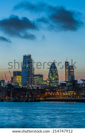 New skyscrapers of the City of London at sunset 2014 including 122 Leadenhall Street, The Gherkin and the Heron Tower - stock photo