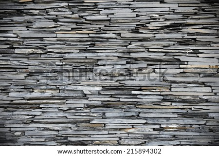 New Slate Stone Wall Background with Plenty of Copy Space - stock photo