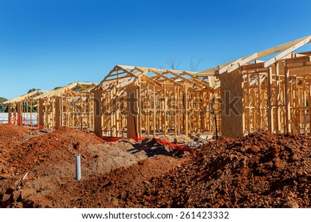 new suburban homes currently under construction in row  - stock photo
