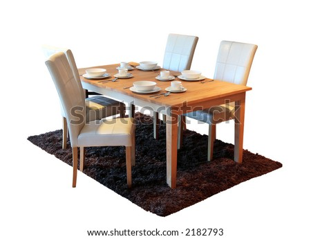 New table and chairs with place settings against isolated white background - stock photo