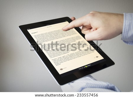 new technologies concept: hands with touchscreen ebook - stock photo