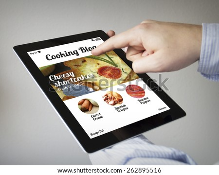 new technologies concept: hands with touchscreen tablet with cooking website on the screen