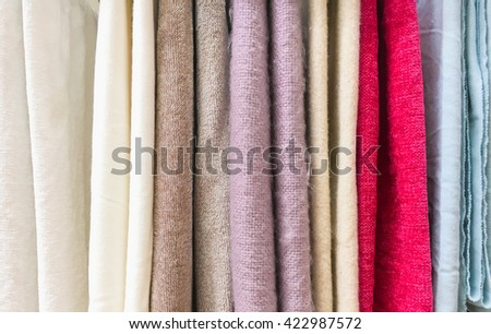 New textiles hanging in a store - stock photo