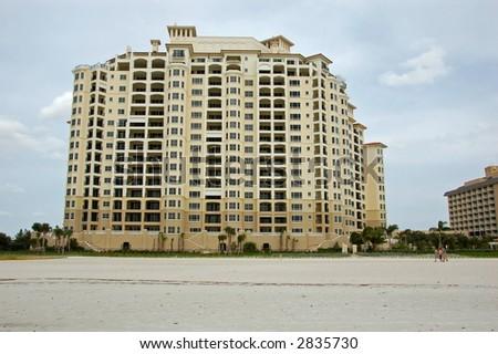 new timeshare construction on Florida beach - stock photo