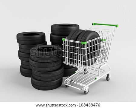 New tires in a shopping trolley on a white background - stock photo