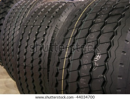 New tires in auto shop, for safe driving - stock photo