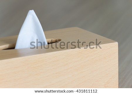 New tissue in wooden box on wood table, tissue box concept, tissue box background, tissue box copy space, tissue box close up, tissue box modern, tissue box bedroom. - stock photo