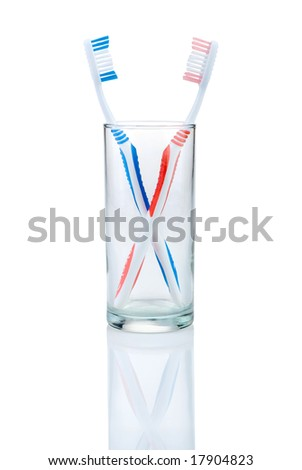 new toothbrush in glass, isolated