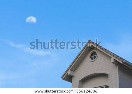 new traditional gable roof house under blue moon cloud sky - stock photo