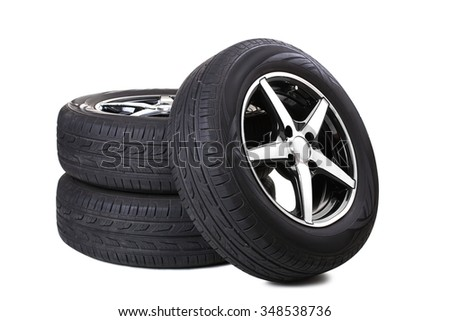 new tyres isolated on white background - stock photo
