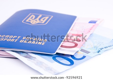 new ukrainian passport with euro money in studio