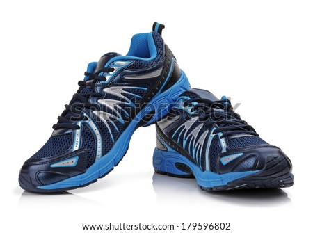 New unbranded running shoe, sneaker or trainer isolated on white - stock photo
