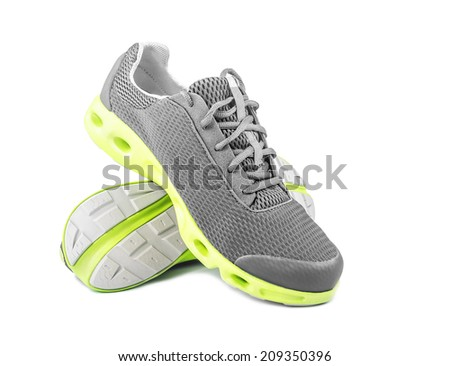 New unbranded running shoes, sneakers or trainers on white - stock photo