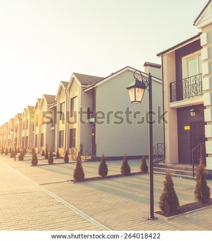 new uptown street houses at spring sunset - stock photo