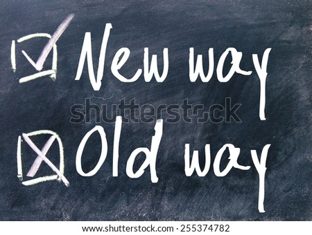 new way and old way choice on blackboard - stock photo