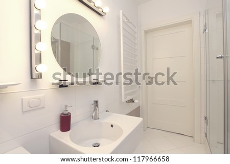 New, white and stylish bathroom in modern house