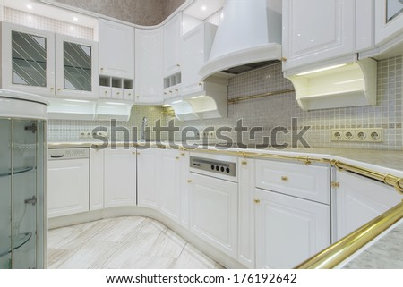 New white luxury kitchen in a modern home - stock photo