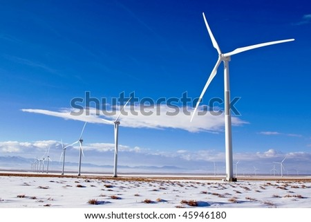New wind turbines produce energy at a high desert wind farm.