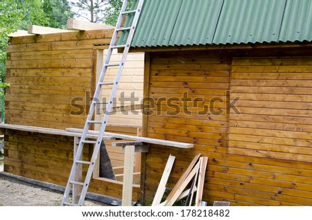 New wooden frame of house under construction - stock photo