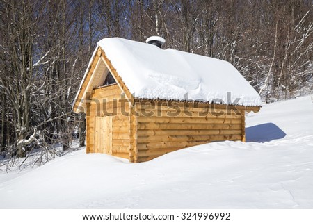 New wooden shelter near hiking trail in Bieszczady - stock photo